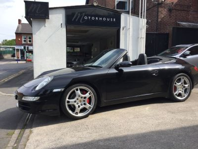 Porsche 911 3.8 Carrera S Convertible Petrol BlackPorsche 911 3.8 Carrera S Convertible Petrol Black at Motorhouse Cheshire Stockport